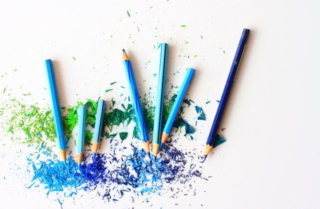 Cool colored pencils and and scattered shavings