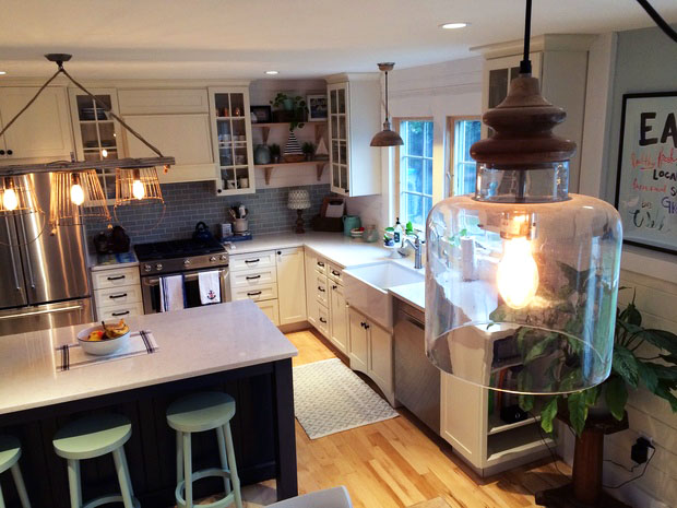 Modern farmhouse kitchen with rustic fixtures and farmhouse sink