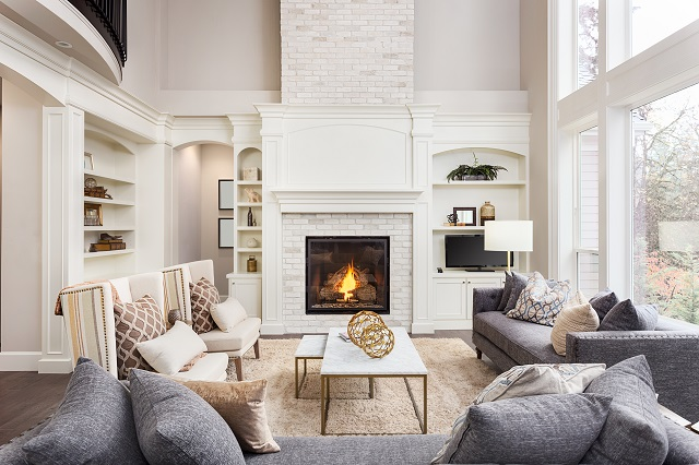 Paint a brick fireplace with this simple how-to guide. Get that clean