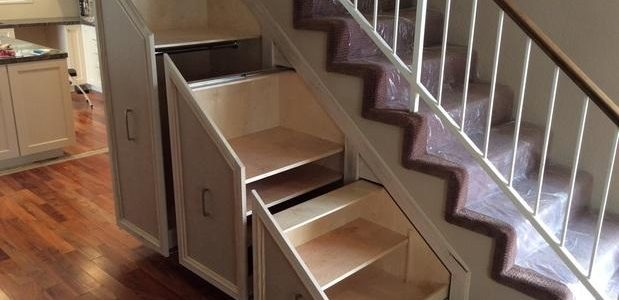 Pull out shelves under stairway