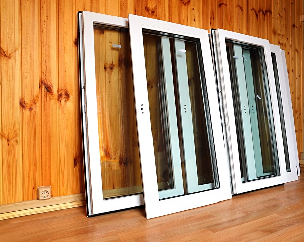 Installation of plastic windows in the wooden house