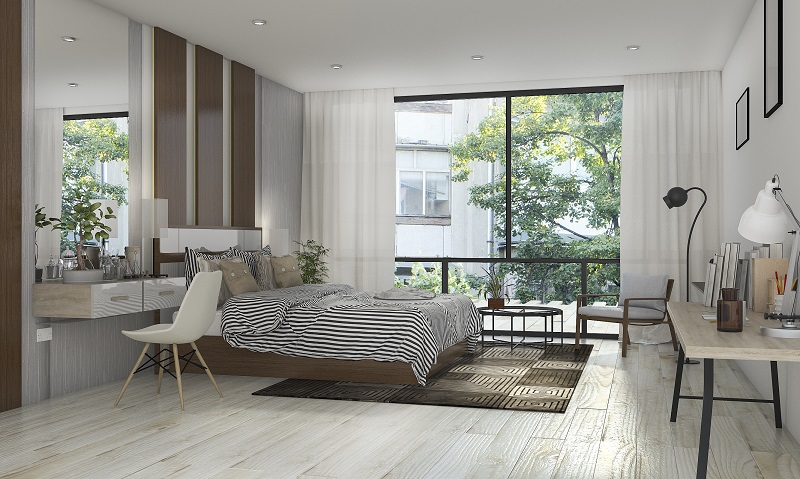 bedroom with laminate flooring
