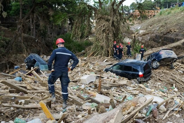 Rescue Service assorted debris after mudslide or flood