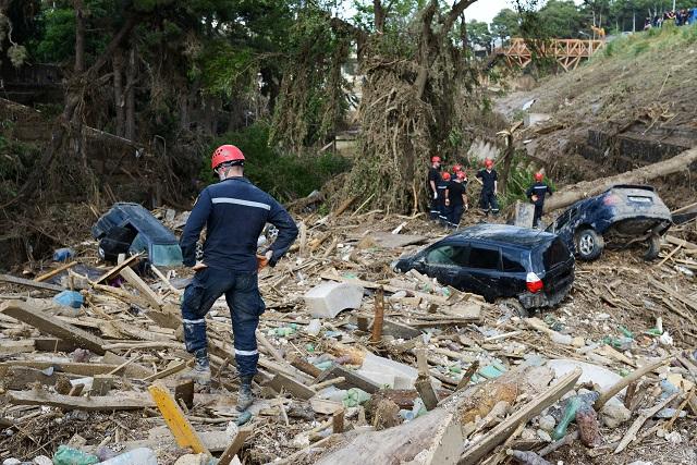 Rescue Service assorted debris after mudslide or flood