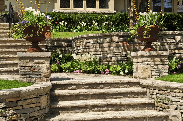 Natural stone landscaping with retaining walls