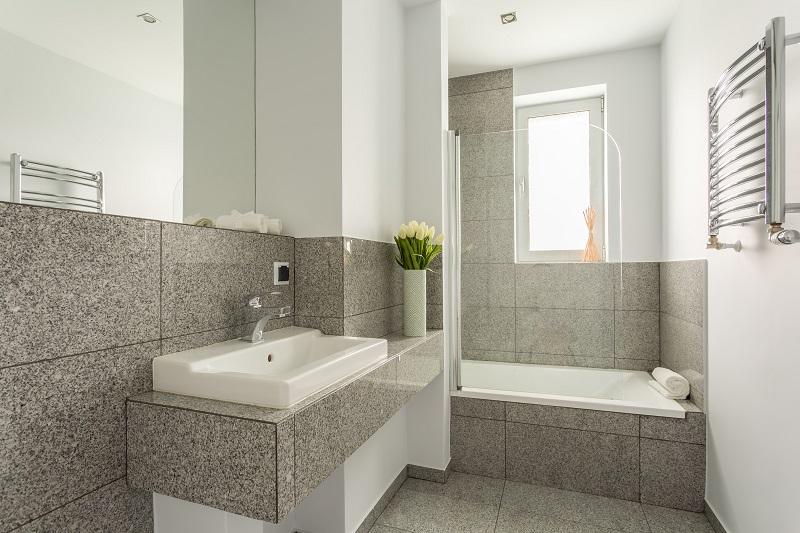 Granite modern bathroom interior with minimalist washbasin and bathtub