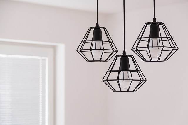 Suspended chandelier in loft style in a modern house interior.