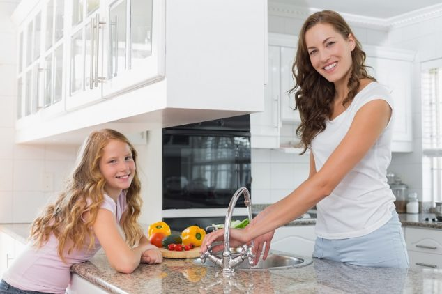 woman and child in kitchen over countertop