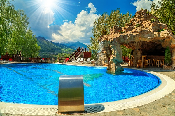 backyard luxury pool with pool grotto bar and waterfall