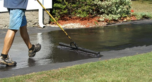 How to seal an asphalt or concrete driveway apply blacktop sealer sealing an asphalt driveway with a brush solutioingenieria Image collections