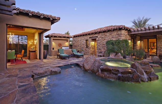 House Exterior with swimming pool and hot tub and patio