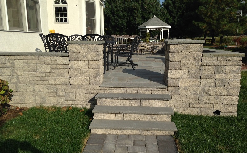 stone paver patio raised with stairs