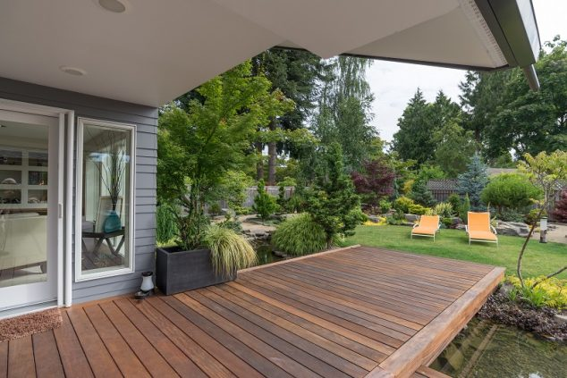 A Perspective View Of A Contemporary Pacific Northwest Home With A Deck  Bridging A Pond That