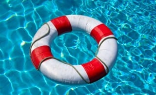 Safety life buoy in blue swimming pool