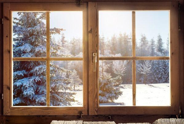 wood window frames overlooking winter scene