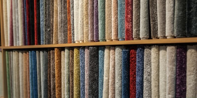 colored carpet display in cabinet