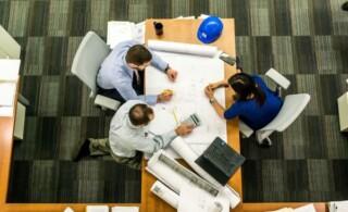 People working on blueprint