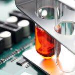 Test tubes set on circuit board