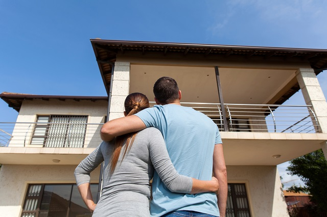 young couple looking at their new house