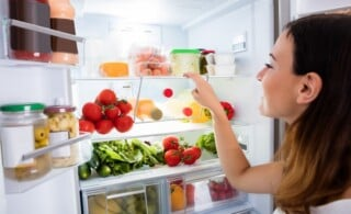 Open fridge filled with fresh foods