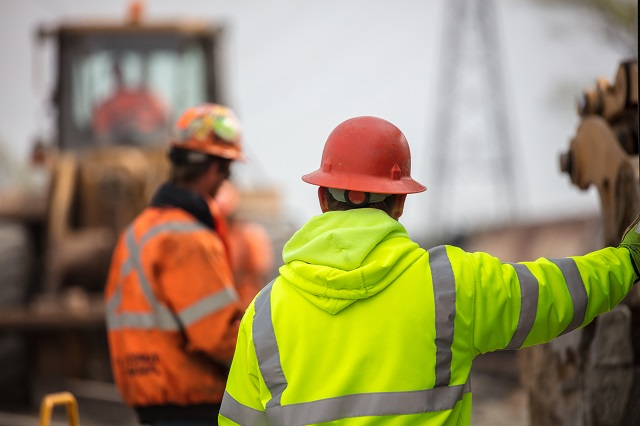 Construction workers on site on a cloudy day