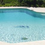 blue saltwater pool in tropical environment