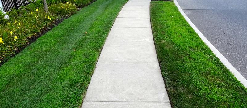 concrete walkway next to road