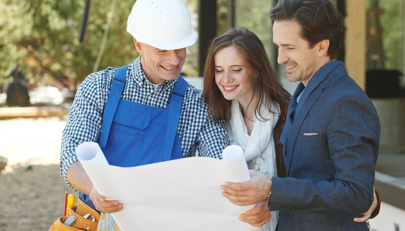 home builder on site shows plans to homeowners