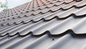 gray metal roofing against sky background