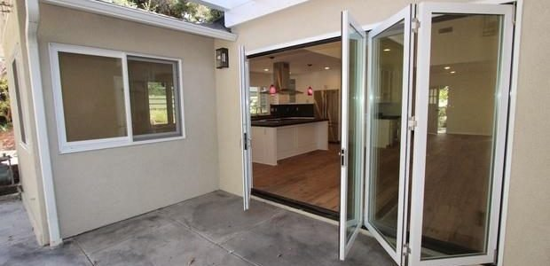 partially folded accordion door between kitchen and patio - Glass Patio Doors