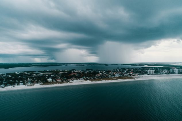 Beach town surrounded by clouds