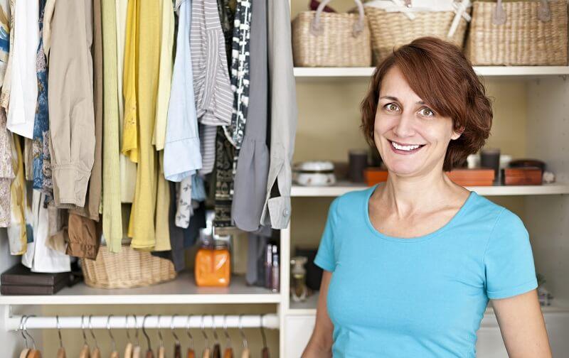 professional organizer in client closet