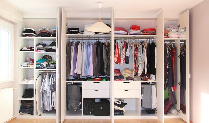 beautiful closet after a closet organizer worked