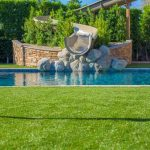 Pool Installation with slide and turf surround