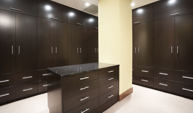 Full-size bedroom closet with dark stain.