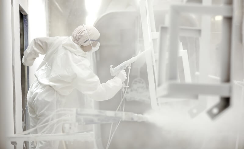 electrostatic painter with powder coating gun in lab