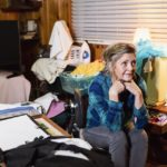 Senior woman at home in a messy room