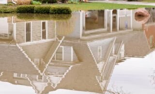 Reflection of suburban home in stormwater flood