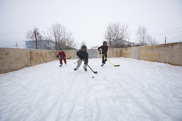 Kids Playing Ice Hockey on a DIY Backyard Rink