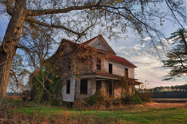 Haunted-looking Farmhouse at Sunset