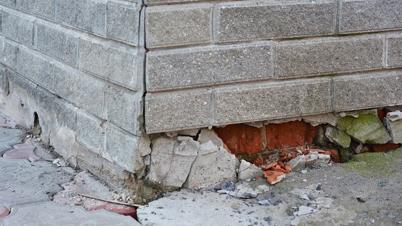 concrete and brick foundation in need of repair