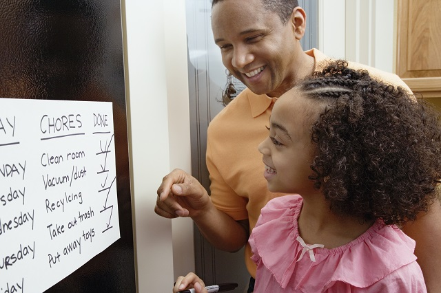 parent and child look at completed chores list