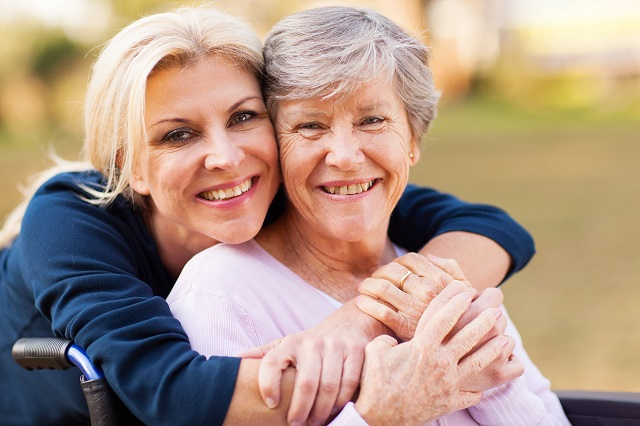 daughter embracing mother with alzheimers