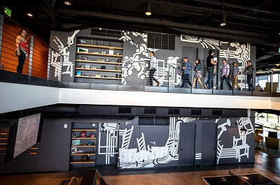 full view of 2-story interior mural painted in Denver, CO