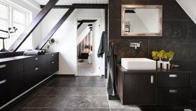 dark wood bathroom with granite stone tile floors