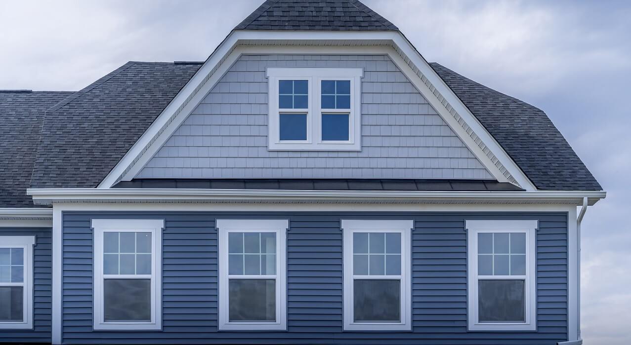 white windows on blue house