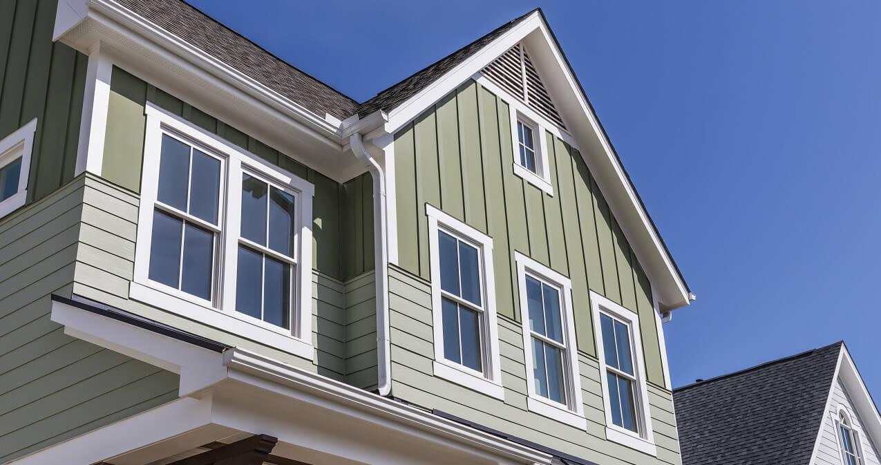 white vinyl windows on residential house