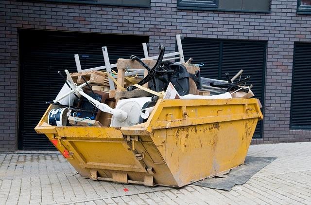full dumpster outside of property