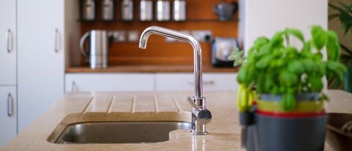 arc faucet on kitchen sink
