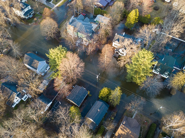 Luxury homes flooded as the river swells into historic neighborhood